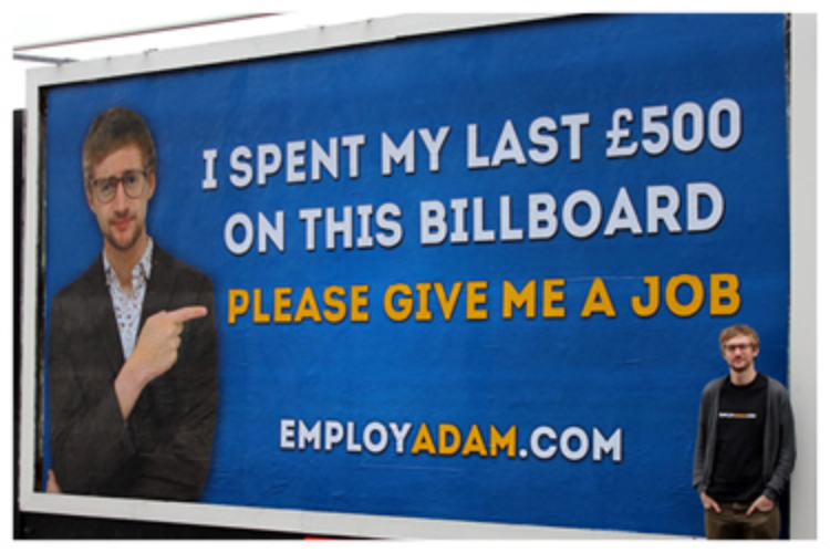 Man with billboard asking for employment