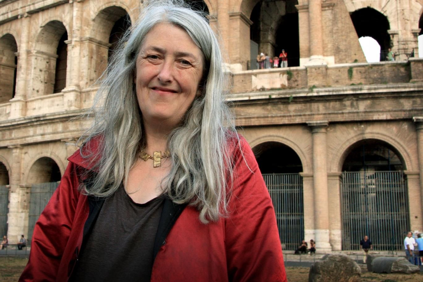 Mary Beard standing in front of Colosseum