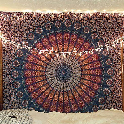 mandala design tapestry hung on a bedroom wall