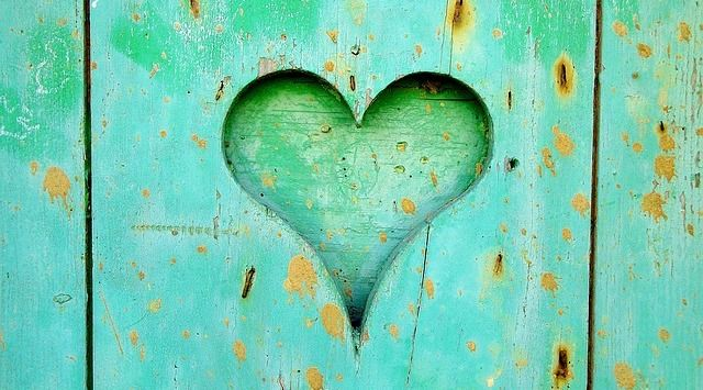 Heart carved out of green wall