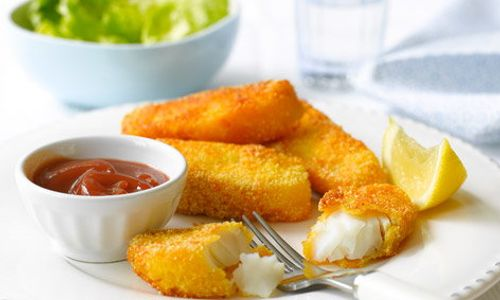 Plate with fish fingers and sauce.