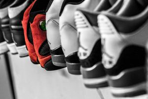 Nike Jordan shoes lined up on a rack.