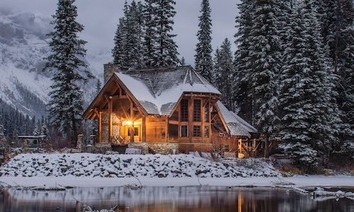 A lakeside house in the winter.