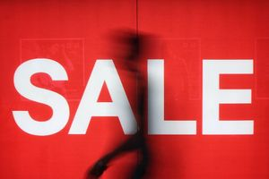 Sale sign in shop window.