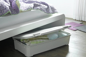A storage box under bed.