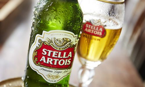 A close up of a bottle of Stella.