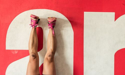 Woman's legs against wall whilst working out.